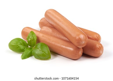 Boiled sausages with basil, isolated on white background.