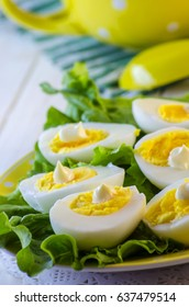 Boiled and shelled chicken eggs on a plate