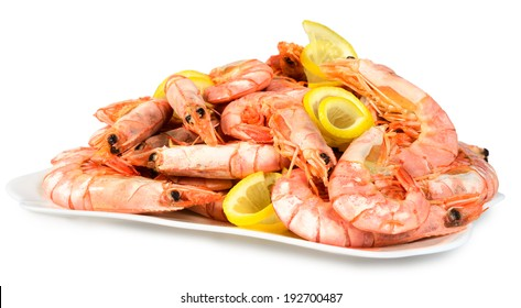 Boiled shrimp with lemon on a plate. Isolated on white background.