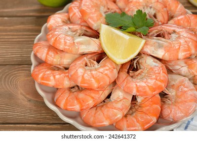 Boiled shrimp on a brown background, close-up
