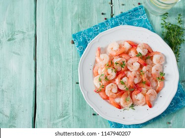 boiled shrimps on wooden surface
