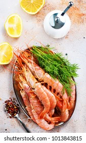 boiled shrimps with spice on plate and on a table