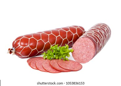 Boiled smoked meat product decorated with leaf of lettuce. Sausage whole and partially sliced. Isolated on white background