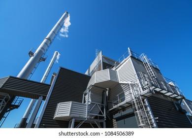 Boiler chimneys on a blue sky background
