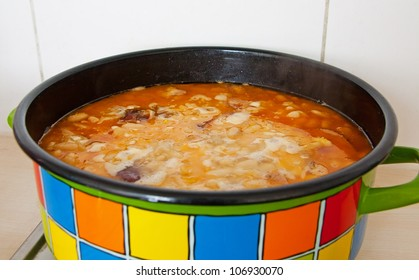 Boiling beans with bacon