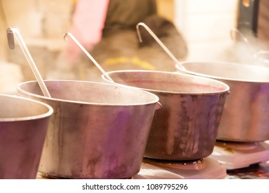 Boiling cauldrons or big pots on street food festival