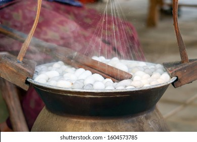 Boiling cocoon silkworm in the pot. Traditional silk production in Thailand.