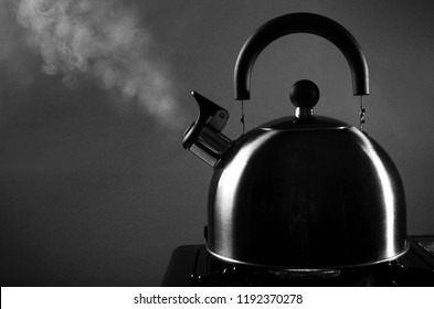 Boiling kettle on a stove with a steam jet
