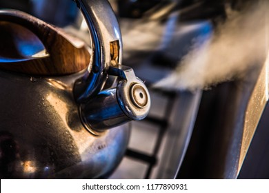 Boiling kettle whistling on a stove