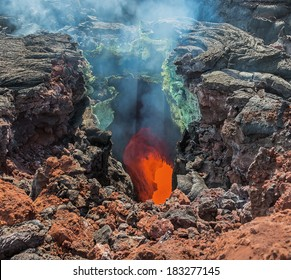 The boiling magma flows through lava tubes under a layer of cooled lava - volcano Tolbachik, Kamchatka, Russia