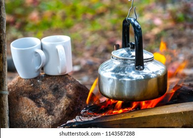 Boiling water with a kettle on the fire at an outdoor campsite for coffee at Ang Thong National Marine Park