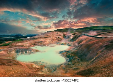 Boiling water lake in the Krafla volcano. Colorful exotic sunset with lava ground in the geothermal valley Leirhnjukur, located near Lake Myvatn in north of Iceland, Europe.