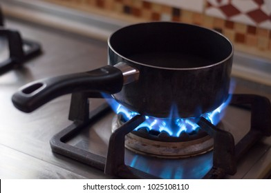 Boiling water in pot with gas flame