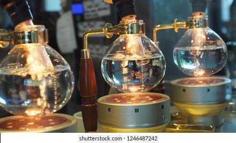 Boiling water in vacuum pot or siphon pot. Vacuum pot coffee maker.