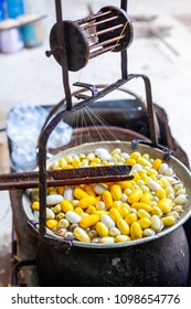 Boiling White and Yellow silkworm cocoons in the pot to make Silk Thread, Boil Silk Nest with Silk Reeling in Thailand