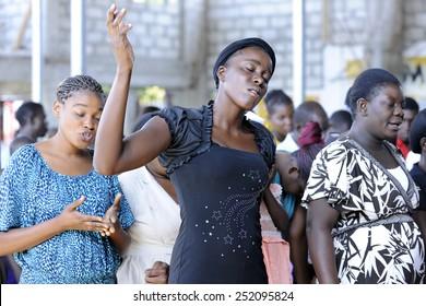 BOIS NEUS, HAITI - FEBRUARY 9, 2014:  Unidentified worshipers  in a Christian church in Bois Neus, Haiti.