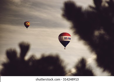 Boise, ID - September 6, 2015: a Remax hot air balloon flies over a Boise neighborhood with a toned instagram filter.  The balloon is one of many participants in the annual Spirit of Boise festival.