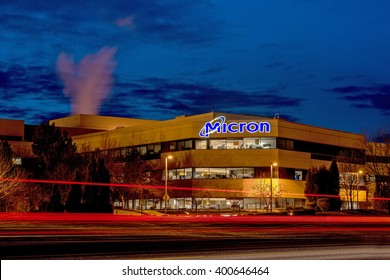 Boise, ID, USA - March 25, 2016: Micron Technology Boise . Micron is a leading company in semiconductor manufacturing.View at night with streaking car-lights.