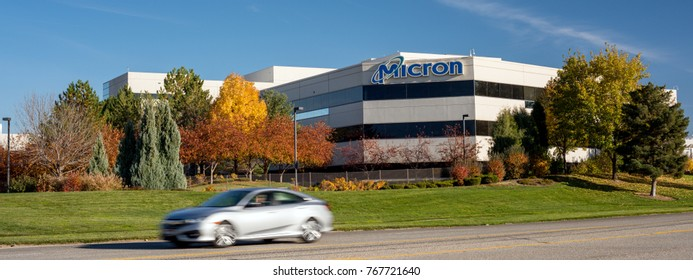 Boise, ID, USA - October 27, 2017: Micron Technology Boise . Micron is a leading company in semiconductor manufacturing. Close up of building frontage with beautiful fall trees and a car passing.