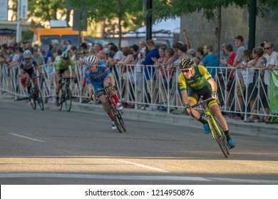 BOISE, IDAHO - JULY 14, 2018: Biker leaning into the turn while racing at the Boise Twlight Criterium