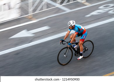 BOISE, IDAHO - JULY 14, 2018: Lone biker working through the course at the Boise Twilight Criterium