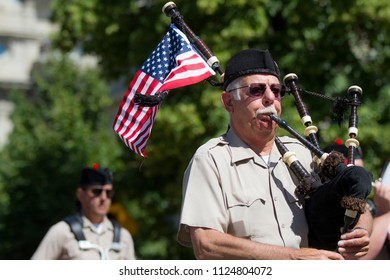 BOISE, IDAHO - JULY 4, 2016: Man using bagpipes during the 4th of July parade in Boise, Idaho
