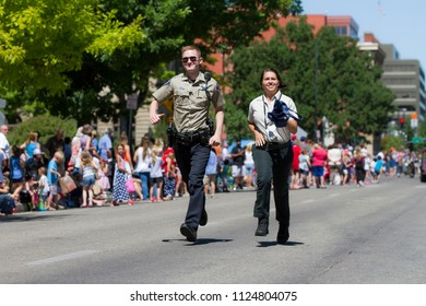 BOISE, IDAHO - JULY 4, 2016: Ada County Sheriffs running during the 4th of July Parade in Boise, Idaho