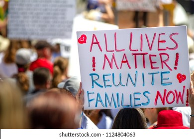 BOISE, IDAHO - JUNE 30, 2018: Sign telling us to reunite families now during the Famlies Belong Together protest in Boise, Idaho