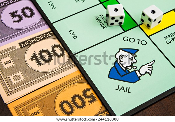 BOISE, IDAHO - NOVEMBER 18, 2012: The monopoly board game was first published by Parker Brothers, currently owned by Hasbro, in 1935