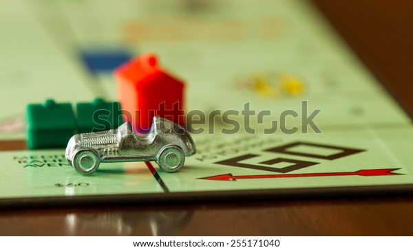 BOISE, IDAHO - NOVEMBER 18, 2012: Car from the game Monopoly speeding past. Game was made by Parker Brothers now owned by Hasbro