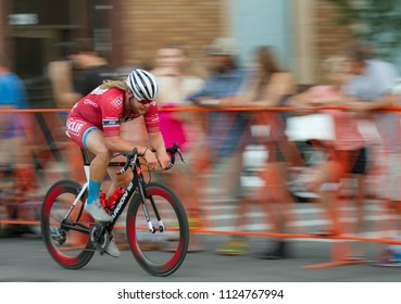 BOISE, IDAHO-JULY 16 2016: Biker moving his way as fast as he can during the Boise Twilight Criterium in Boise, Idaho