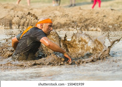 BOISE, IDAHO/USA - AUGUST 10: Unidentified participant runs while making a splash at the The Dirty Dash in Boise, Idaho on August 10, 2013