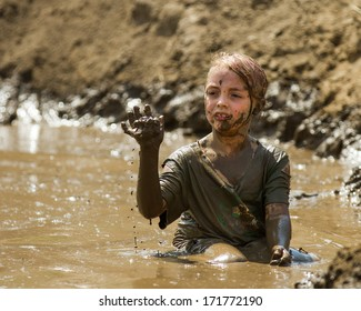BOISE, IDAHO/USA - AUGUST 11, 2013: Unidentified child plays with the mud at the dirty dash