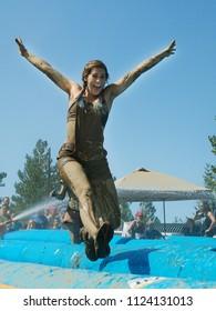 BOISE, IDAHO/USA - AUGUST 25: Woman leaping through the air at the dirty dash in Boise, Idaho