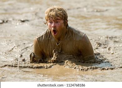 BOISE, IDAHO/USA - AUGUST 8, 2014: Person swimming their way through the mud at the Boise Dirty Dash