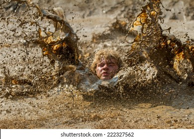 BOISE, IDAHO/USA - AUGUST 8, 2014: Unidentified person makes a huge wave the Dirty Dash in Boise, Idaho