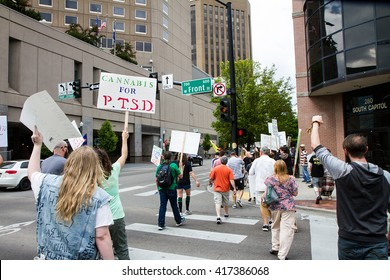 BOISE, IDAHO/USA - MAY 7, 2016: Group of people during their march to the capital in support for legal marijunana in Boise, Idaho