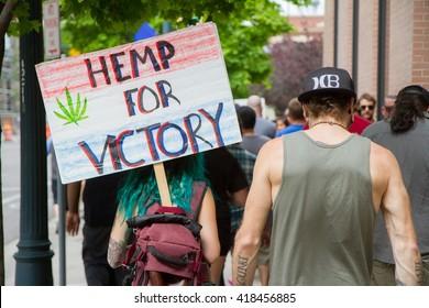 BOISE, IDAHO/USA - MAY 7, 2016: Woman walking to the Boise Capital during the Global Marijuana March in Boise