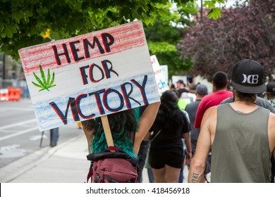 BOISE, IDAHO/USA - MAY 7, 2016: Displaying a Hemp for Victory sign a woman marches to the capital during the Global Marijuana March in Boise