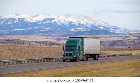 Boise, Montana, USA - December 20, 2017: Green semi truck with white trailer driving on highway
