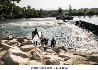 Boise/Idaho: 11th September 2017- Surfing is one of the favorite sport during the summer. Locals are spending most of the weekend surfing at the river.