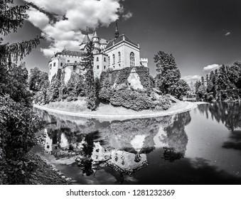 Bojnice castle is mirrored in water, Slovak republic. Cultural heritage. Travel destination. Black and white photo.