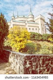 Bojnice castle in Slovak republic. Yellow autumn trees. Cultural heritage. Seasonal scene. Vibrant colors. Yellow photo filter.
