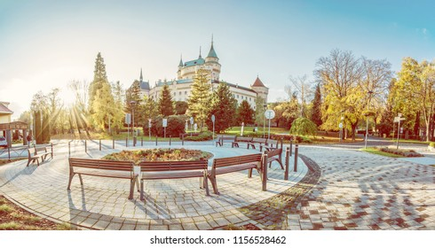 BOJNICE, SLOVAKIA – OCTOBER 31, 2017: Bojnice castle with surrounding area in autumn, Slovak republic. Sunset scene. Travel destination. Yellow photo filter.