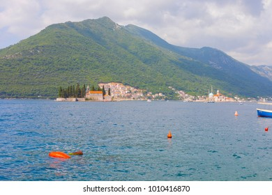 Boka Kotorska (gulf of Kotor) with two islands Gospa od Skrpjela (Our Lady of the Rocks) and Sveti Dordje. Strait of Kotor Bay in mountains. Adriatic sea. Montenegro