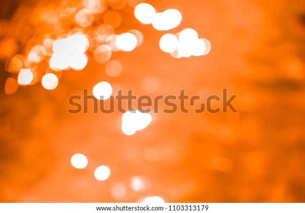 Bokeh abstract orange background.