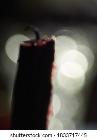 Bokeh background black candle with white circles.