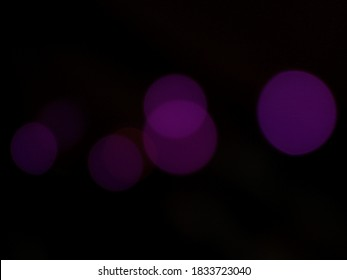 Bokeh background, black with purple circles. Central overlap circles.