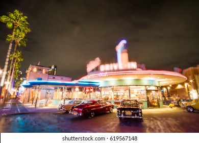 bokeh background of classic drive-in restaurants, american classic car parking outside, picture like a movies