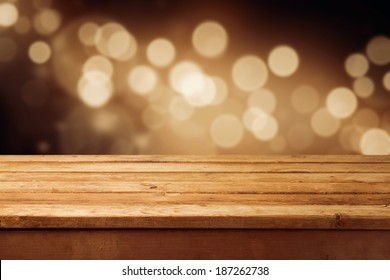 Bokeh background with empty wooden deck table for product montage display